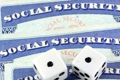 White Dice Laying on Social Security Card Stock Photography