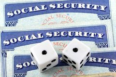 White Dice Laying on Social Security Card Stock Photos
