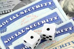 White Dice Laying on Social Security Card Royalty Free Stock Photos