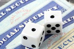 White Dice Laying on Social Security Card Royalty Free Stock Photo