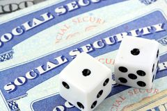 White Dice Laying on Social Security Card Royalty Free Stock Image