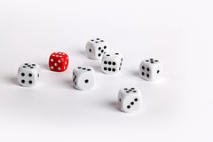 White dice with one red dice Royalty Free Stock Photos