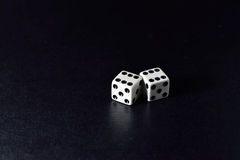 White dice pair on black background. Closeup royalty free stock photography