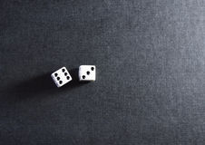 White dice pair on black background. Closeup royalty free stock photos