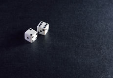 White dice pair on black background. Closeup royalty free stock images