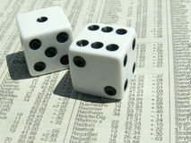 White dice on stock report Royalty Free Stock Photos