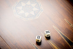 White dice on wooden background. All number six. Concept of luck, chance and leisure fun Royalty Free Stock Photos