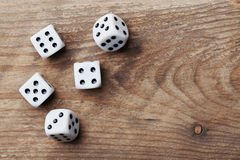 White dice on wooden table from above. Gambling devices. Game of chance concept. Royalty Free Stock Photos