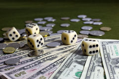 White Dices,Coins and American Dollar Banknotes on Green Surface Royalty Free Stock Images