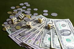 White Dices, Coins and American Dollar Bills on Green Table Royalty Free Stock Photos