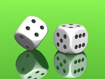 White dices on green background Stock Photos