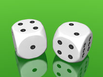 White dices on green background Royalty Free Stock Image