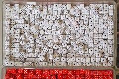 White dices. White plastic dice die pendants Stock Photography