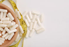 White  diet capsules Stock Photos