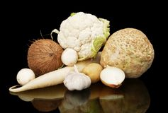 White dietetic vegetables-coconut,onion,selery on black Royalty Free Stock Photo