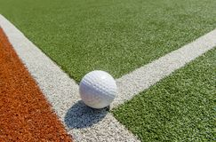 White dimple hockey ball on astro turf.  royalty free stock image