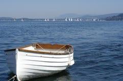 White dinghy in Bellingham Bay. A white skiff/dory floating along in Bellingham Bay, Washington Stock Photo