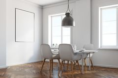 White dining room corner, wooden floor, poster. White dining room corner with a wooden floor, a white table with chairs and a framed vertical poster above it. 3d Royalty Free Stock Photography