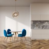 White dining room interior, blue chairs. White wall dining room and kitchen interior with a wooden floor, a round table and blue chairs. 3d rendering mock up Stock Photography