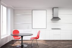 White and wooden dining room, red chairs. White dining room interior with a concrete floor, a black round table with two red chairs standing near it and a framed Royalty Free Stock Images