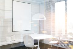 White dining room, table and poster side toned. White dining room interior with a concrete floor, a round table with two white chairs standing near it and a Stock Photography