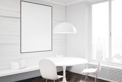 White dining room interior, table and poster side. White dining room interior with a concrete floor, a round table with two white chairs standing near it and a Royalty Free Stock Photo