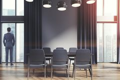White dining room, black curtains, dark toned Stock Images