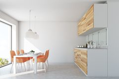 White dining room and kitchen, orange chairs Royalty Free Stock Photo