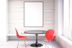 White dining room, red chairs close up. White dining room interior with a concrete floor, a black round table with two red chairs standing near it and a framed Royalty Free Stock Photos