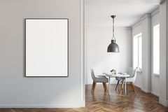White dining room, wooden floor, poster on wall. White dining room interior with a wooden floor, and a white table with chairs. A poster. 3d rendering mock up Stock Photography