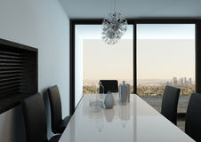White dining table against floor to ceiling window Royalty Free Stock Images