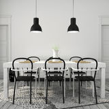 White dining table with black chairs Stock Photos