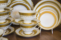 White dining tableware set. Province style tableware in white and golden color. Closeup photo with lots of copy space Royalty Free Stock Images