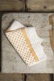 White Dinner Napkin with Orange Polka Dots and Stripes Design Stock Photography