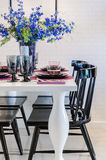 White dinning table with black chair in dinning room Stock Image