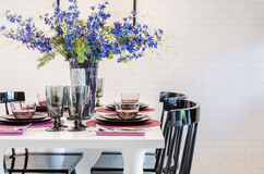 White dinning table with black chair in dinning room Royalty Free Stock Image