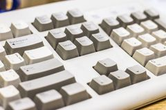 White and dirty keyboard of an old desktop computer royalty free stock photo