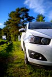White dirty passenger car on rural yard Stock Image