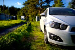 White dirty passenger car on rural yard Royalty Free Stock Photo