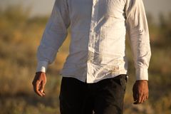 White dirty shirt on a man in the nature royalty free stock image