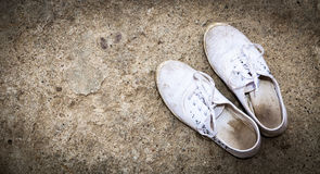 White dirty shoes Royalty Free Stock Image