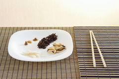 White dish with black rise, mussels and squid Stock Images