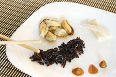 White dish with black rise, mussels and squid Royalty Free Stock Photography