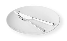 White dish with folk and knife Stock Photo