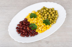 White dish with green peas, beans, sweet corn and parsley Royalty Free Stock Images