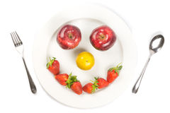 White dish happy. With fruit and vegetable Stock Images