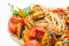 A white dish with Pasta spaghetti , mussel and tomatoes. White dish with Pasta spaghetti , mussel and tomatoes Stock Photo