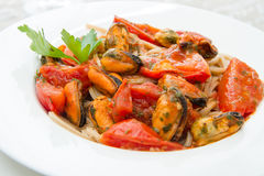 White dish with Pasta spaghetti , mussel and tomatoes. A white dish with Pasta spaghetti , mussel and tomatoes Stock Images