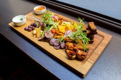 Dish with ribs and vegetables on table Stock Photography