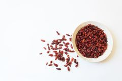 White dish and scattered piquin bird peppers Capsicum annuum Pequin pepper, food ingredient, dried red, isolated on. White, horizontal aspect royalty free stock photos